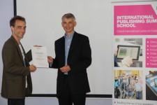 Eric Meredith receiving his award
