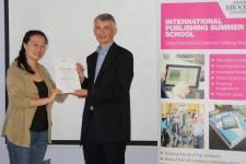 Jiang Jie receiving her award