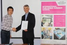 Tetsuya Imamura receiving his award