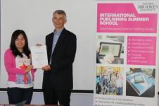 Yanbo Xing receiving her award