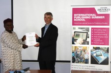Hilary Enenche receiving her award