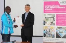 Nana Atakora Brenya receiving his award