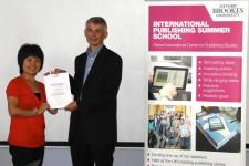 Wang LinLin receiving her award