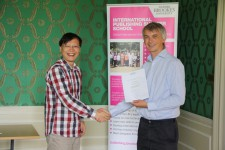 Ma Tiankui receiving his certificate from Angus Phillips