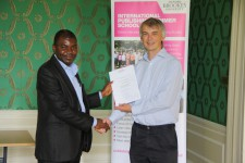 Kenneth Obinyan receiving his certificate from Angus Phillips