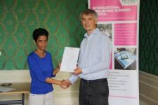 Varuni Asanka de Silva receiving her certificate from Angus Phillips