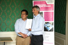Jiang Xudong receiving his certificate from Angus Phillips