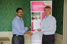 Haseeb Irfanullah receiving his certificate from Angus Phillips
