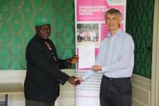 Adetayo Adegbite receiving his certificate from Angus Phillips