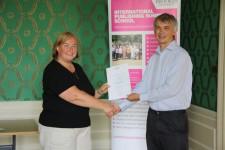 Lea Adamson receiving her certificate from Angus Phillips