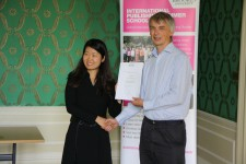 Li Qing receiving her certificate from Angus Phillips