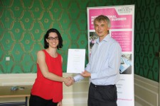 Elettra Capisani receiving her certificate from Angus Phillips