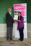 Rashmi Mittal receiving her certificate from Angus Phillips