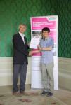 Liu Zhanwei receiving his certificate from Angus Phillips