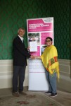 Neha Thakore receiving her certificate from Angus Phillips