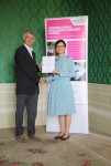 Zheng Minmin receiving her certificate from Angus Phillips