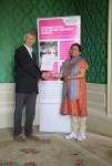 Nagalakshmi Balakrishnan receiving her certificate from Angus Phillips