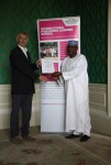 Ahmed Abba Nura receiving his certificate from Angus Phillips