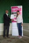 Eva Levin receiving her certificate from Angus Phillips