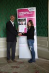 Rebecca Mutch receiving her certificate from Angus Phillips