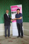 Zhao Peng receiving his certificate from Angus Phillips