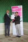 Youfu Wang receiving his certificate from Angus Phillips