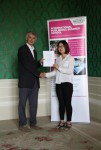 Soyon Chung receiving her certificate from Angus Phillips