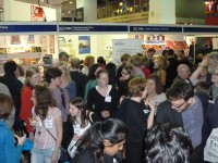 Crowds enjoying the Alumni Group launch party at the OICPS stand