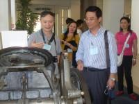 Mr. Zhang Peng and Mr. Liu Huapin, Deputy Professors of Editorship, at an old press on OUP tour