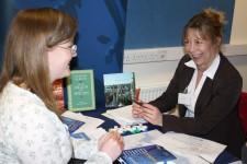Annabel Perrett, Cambridge University Press, talks to a Brookes postgraduate student