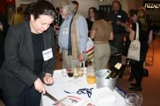 Rosalyn Dobrzanski cutting the OICPS cake